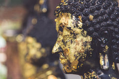 Closeup of Buddha statue gilded in the measure Stock Photography