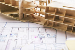 Closeup of building model and a construction plan. Stock Image