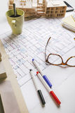 Closeup of building model and drafting tools on a construction plan. Stock Photography