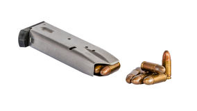 Closeup of bullets and magazine for gun Stock Images