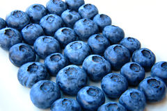 Closeup of a bunch of fresh and delicate blueberries Stock Photos