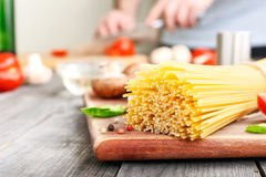Closeup bunch of Italian spaghetti on a wooden table Royalty Free Stock Photo