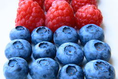 Closeup of a bunch of raspberries and blueberries Royalty Free Stock Photos