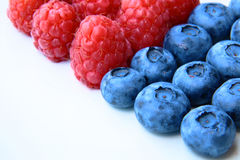 Closeup of a bunch of raspberries and blueberries Stock Photo
