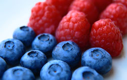 Closeup of a bunch of raspberries and blueberries Royalty Free Stock Photography
