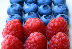 Closeup of a bunch of raspberries and blueberries Stock Photos