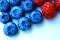 Closeup of a bunch of raspberries and blueberries Stock Photography
