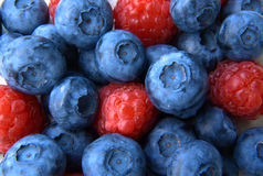 Closeup of a bunch of raspberries and blueberries Stock Image