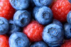 Closeup of a bunch of raspberries and blueberries Royalty Free Stock Photo