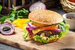 Burger made from vegetables. Closeup of burger made from vegetables on old wooden table stock photo