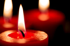 Closeup of burning candles on black background, christmas, holid Stock Image