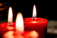 Closeup of burning candles on black background, christmas, holid Stock Photography