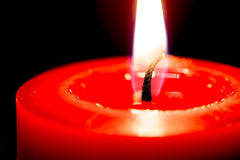 Closeup of burning candles on black background, christmas, holid Royalty Free Stock Image