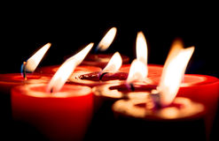 Closeup of burning candles on black background, christmas, holid Royalty Free Stock Images