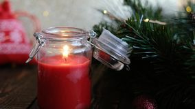 Closeup of burning christmas candles and decorations