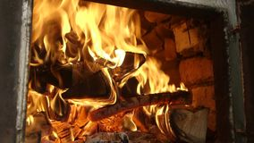 Closeup of burning fire in old stove. The old authentic Ukrainian oven. stock video footage