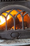 Closeup of burning fire wood in home fireplace. Heating Royalty Free Stock Photo