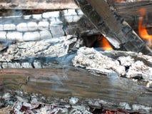 Closeup of burning fire wood logs and ash Stock Photos