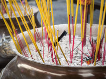 Closeup burning incense sticks in temple Stock Photo