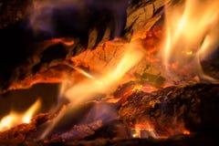 Closeup of burning wood Stock Images