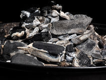 Closeup of burnt charcoal on a barbeque Stock Photography