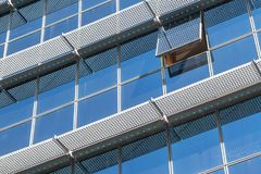 Closeup of a business building. Corporate concept. Abstract detail of modern glass building with an open window Stock Photography