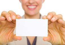 Closeup on business card in hand of business woman Stock Images