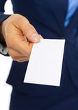 Closeup on business card in hand of business woman Stock Image