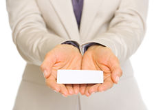 Closeup on business card in hand of business woman Royalty Free Stock Photo
