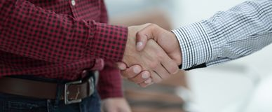 Closeup of a business hand shake between two colleagues Stock Photography
