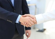 Closeup of a business hand shake Stock Photos