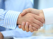 Closeup of a business hand shake Royalty Free Stock Images