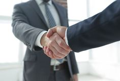 Closeup of Business Leader Shaking Partner Hand. Photo with copy space Stock Image
