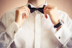 Closeup of business man adjusting neck bow Royalty Free Stock Image