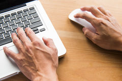 Closeup of business man hand typing on laptop keyboard. Business man hand typing on laptop keyboard Royalty Free Stock Photo