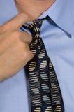 Closeup of business man loosening tie - collar Stock Photography