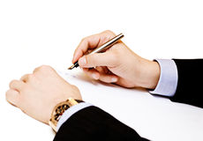 Closeup of a business man making a note Royalty Free Stock Photos