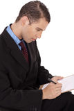 Closeup of a business man writing down Stock Photo