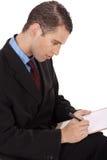 Closeup of a business man writing down Stock Photo