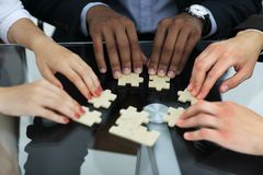 Free Closeup.business Partners Accounting For The Puzzle Pieces Royalty Free Stock Photography - 133637397