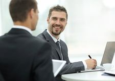 Closeup.business partners discussing business issues. Sitting behind a Desk.photo with copy space Stock Photo