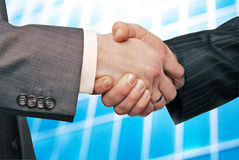 Closeup of business people shaking hands Royalty Free Stock Photography