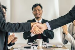 Closeup of a business people shaking hands, finishing up a meet. Ing Royalty Free Stock Image