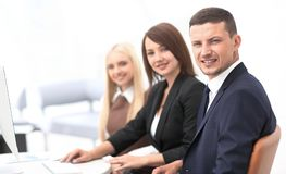 Closeup of business people sitting at a meeting the conference room. The business concept royalty free stock image