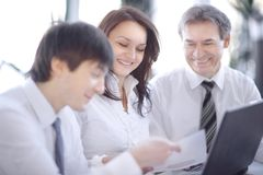 Closeup. business team discussing a new contract. Closeup. successful business team discussing a new contract royalty free stock image