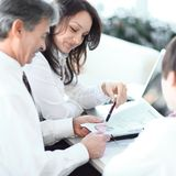Closeup. business team discussing a new marketing scheme. royalty free stock photography