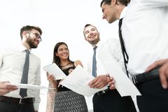 Closeup of business team discussing work documents Stock Photos