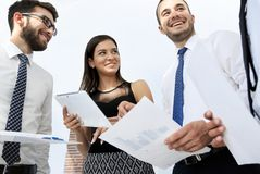 Closeup of business team discussing work documents Royalty Free Stock Image