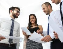 Closeup of business team discussing work documents Stock Photo