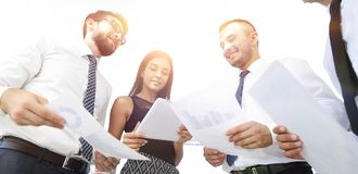 Closeup of business team discussing work documents Royalty Free Stock Photos